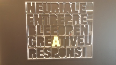 Wall decoration with recycled material possibly Helvetica font